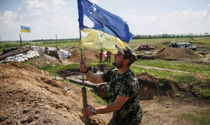 Ukraine soldier raising flag